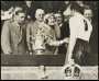 Image of : Photograph - The Duchess of York watched by the Duke, presenting the F.A. Cup to Dixie Dean after Everton's win against Manchester City in the Final at Wembley